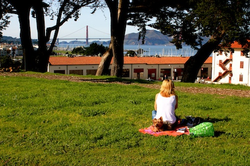 Girl on a sunny day in San Francisco with view of Golden Gate Bridge