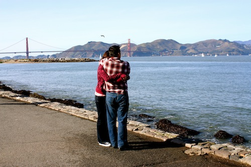 Couple embracing in front of the Golden Gate Bridge