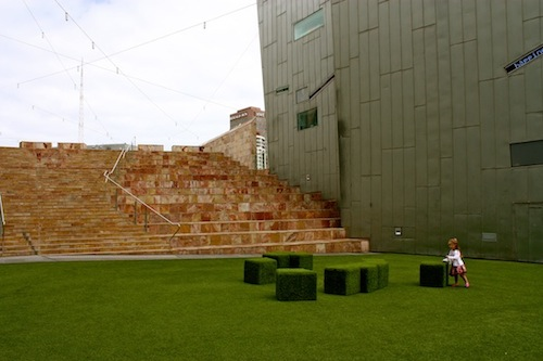 Girl playing in Federation Square, Melbourne, Australia