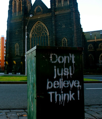 Don't just believe, think in front of cathedral in Melbourne, Australia