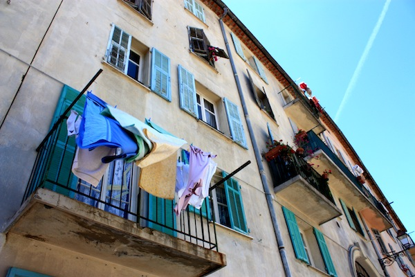 Laundry blowing from a balcony in Nice, France