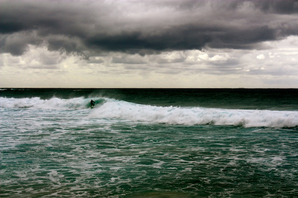 Surfer on a stormy day at Bronte Beach, Sydney, Australia