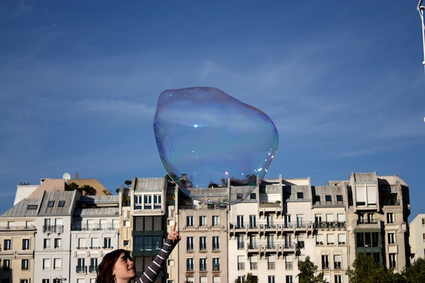 Girl touching a bubble at Centre Pompidou, Paris, France