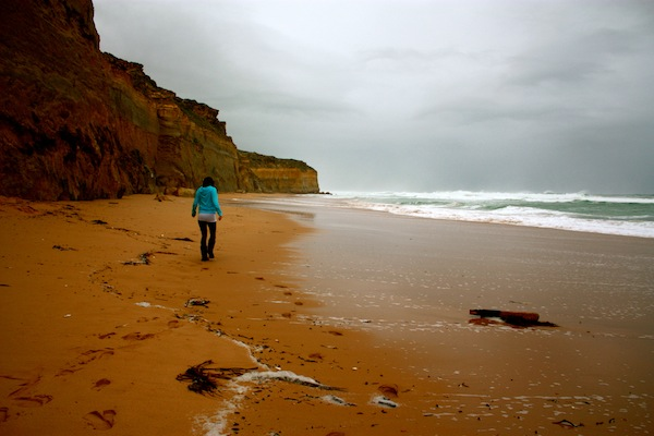 Lone girl on beach along the Great Ocean Road