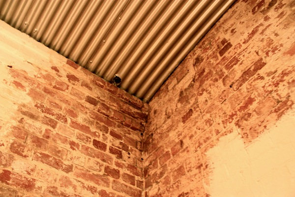 Brick walls and steel ceiling in the basement of Donkey Wheel House, Melbourne, Australia