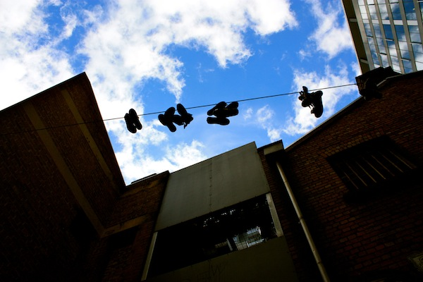 Sneakers hanging in ACDC Lane, Melbourne CBD, Australia