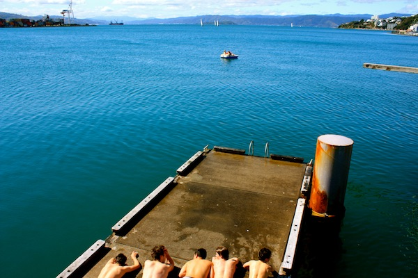Teenage boy swimmers on the Wellington waterfront harbour, New Zealand