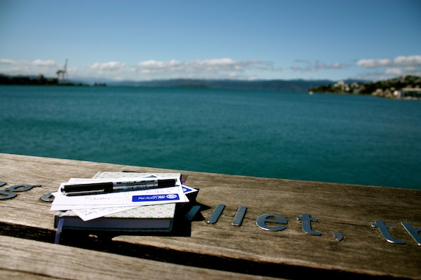 Journal and postcards on the Wellington waterfront, New Zealand