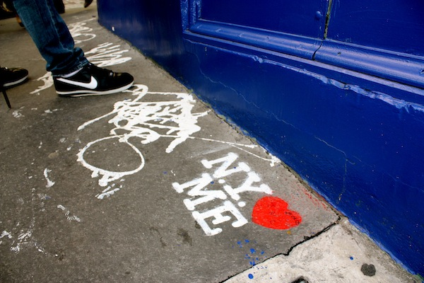 Street art in Paris, France with the shoe of Rex Flores