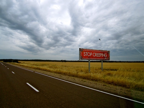 Stop Creeping road sign, View from the Eyre Highway, South Australia