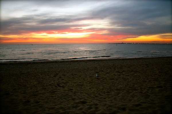 View of sunset over Port Phillip Bay from St Kilda Beach