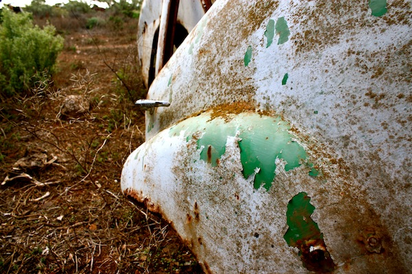 Broken green car at Koonalda Homestead, Old Eyre Highway, Nullarbor campsite, Australia