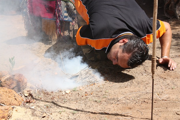 Josh making fire in the traditional Aboriginal way, Yallingup, Western Australia
