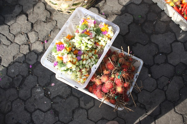 Flower petals for Balinese offerings and rambutans, Ubud Market, Bali, Indonesia
