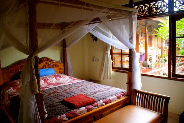 I was distracted by the mosquito net canopy bed at Nyoman Murjana Homestay.