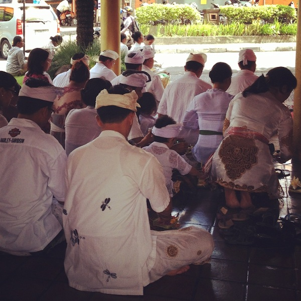 Balinese people praying at a festival, Seminyak, Bali, Indonesia