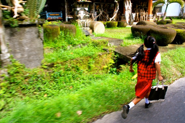 Little girl running to school, Ubud, Bali, Indonesia