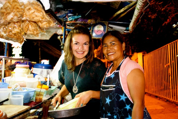 Christine Amorose & new friend at Thai street food cart, Chiang Mai, Thailand
