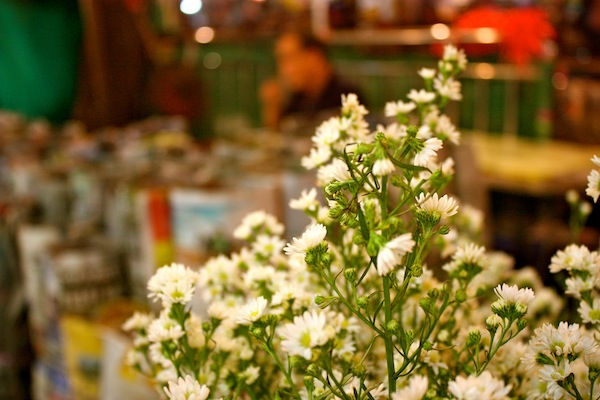 Small white flowers in busy 24-hour Bangkok flower market, Thailand