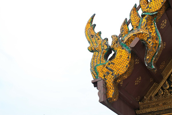 Yellow corner dragon at the Grand Palace in Bangkok, Thailand