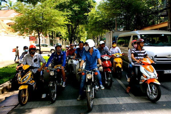 Crossing the crowded street in Saigon, Ho Chi Minh City, Vietnam