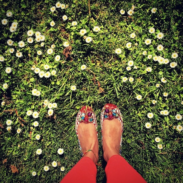 Peep toes and daisies on the first day of spring in San Francisco, California