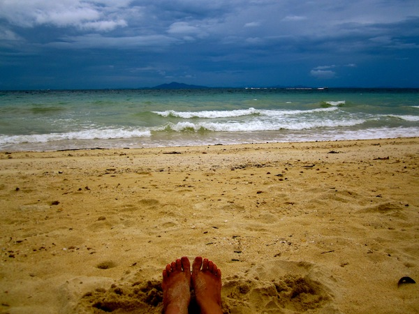 Sand in between my toes on Tohko Beach, Phi Phi Island, Thailand