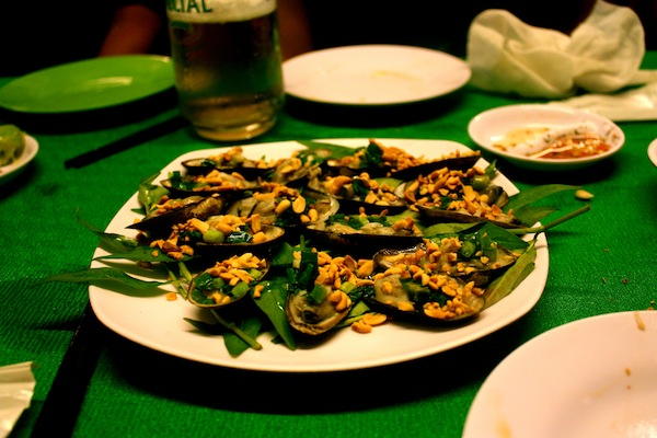 BBQ Mussels with peanut and spring onions on Saigon After Dark tour with Vietnam Vespa Adventures