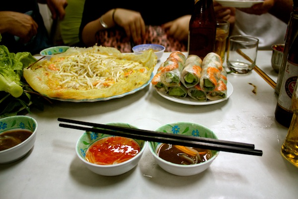 Crispy pancake and spring rolls on Saigon After Dark tour with Vietnam Vespa Adventures