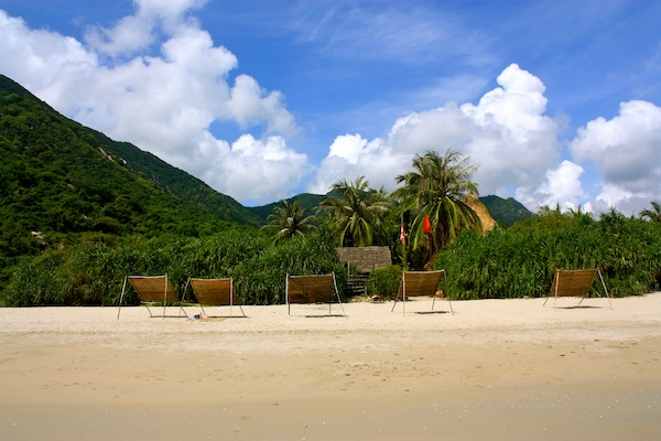 The sandy beach set-up and mountainous backdrop at Jungle Beach Resort, Nha Trang, Vietnam