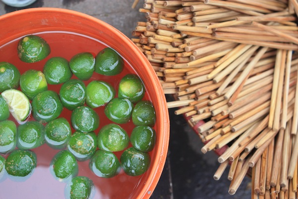 Limes and chopsticks at a street food stall in Hanoi, Vietnam