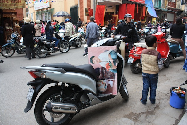 After-school pickup on motorcycles in Hanoi, Vietnam