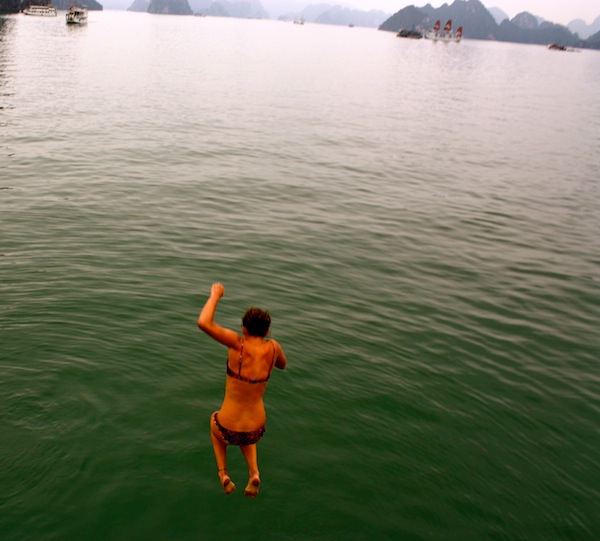 Christine Amorose jumping in water with Rock Long Rock Hard Halong Bay tour in Vietnam