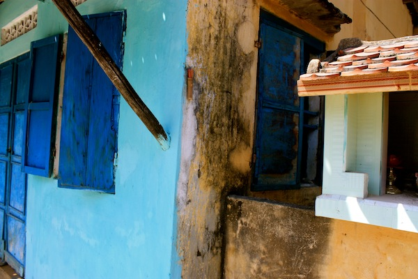 Turquoise paint and blue shutter on house in Hoi An, Vietnam