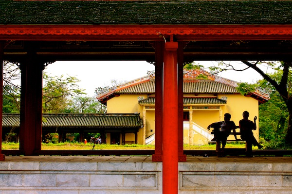Silhouette of two men on temple grounds at Hue Imperial City Citadel, Vietnam