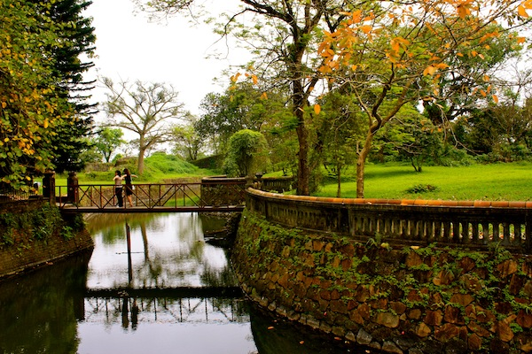 Moat and autumn trees at Hue Imperial City Citadel, Vietnam