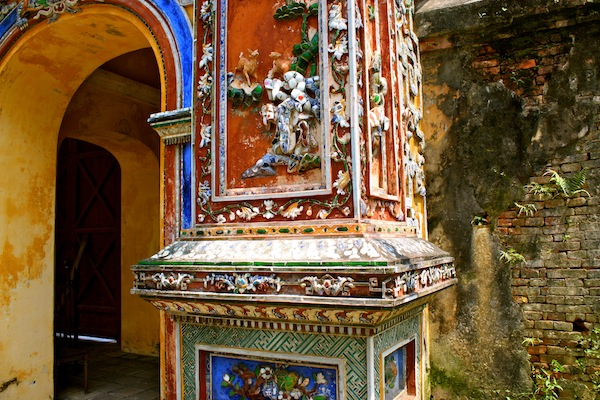 Porcelain art on column at Imperial City of Hue Citadel, Vietnam