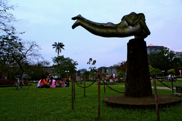 Sculpture and groups at riverfront park along the Perfume River in Hue, Vietnam