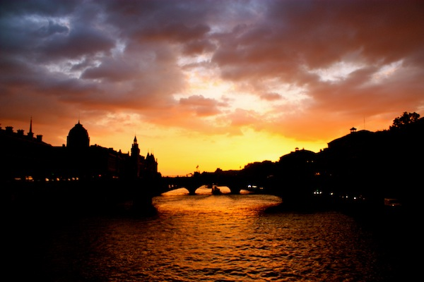 Orange and purple sunset over the Seine River in Paris, France