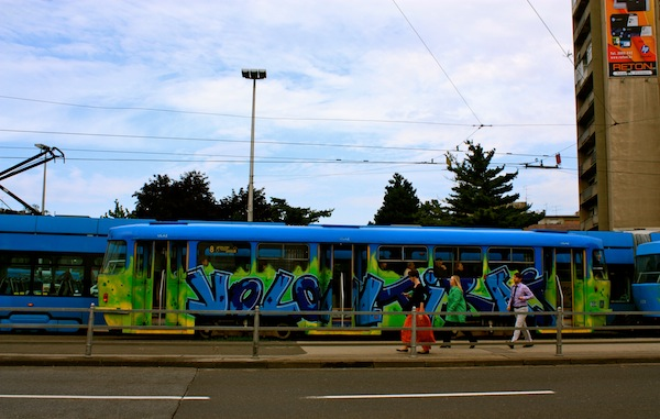 Graffiti trams in Zagreb, Croatia on a beautiful day with blue skies