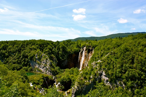 Waterfall and blue skies in Plitvice Lakes National Park, Croatia