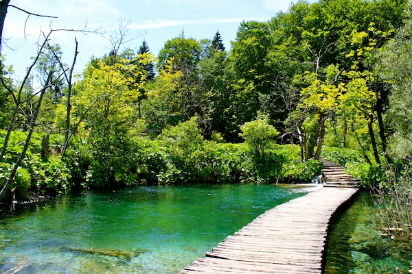 Pathway through the clear blue pools at Plitvice Lakes National Park, Croatia