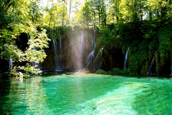 Sun-drenched waterfall in Plitvice Lakes National Park, Croatia
