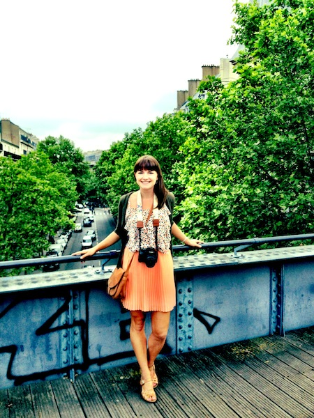 Brown accessories, coral pleated skirt and polka-dotted tank in Paris, France