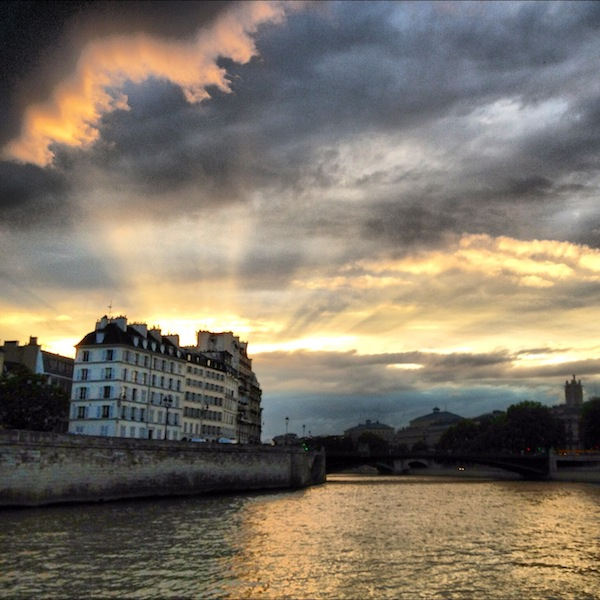 Clouds and rays of sun during sunset on the Seine in Paris, France via instagram