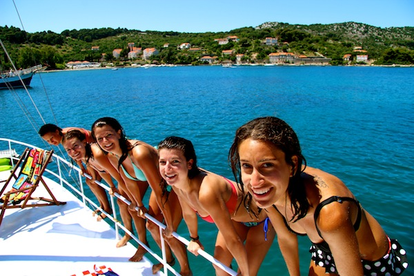 Girls jumping off the boat into the Adriatic Sea on Busabout Croatia sailing trip