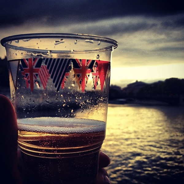 Champagne in Jubilee glasses on the Seine at sunset in Paris, France