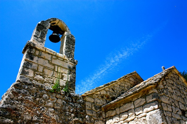 Abandoned building in Split, Croatia against a blue sky
