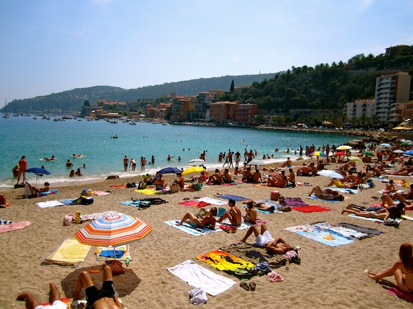 Villefranche beach plage on a Saturday in the French Riviera, France