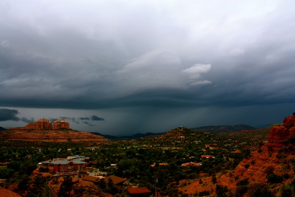 Sedona red rocks under incoming storm clouds in Arizona, USA